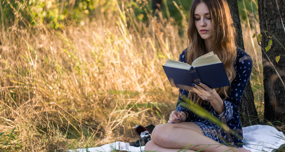 A girl reads poetry