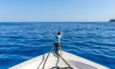 Santorini in Greece has clear blue, shark free oceans.